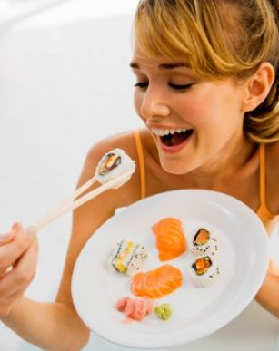 pregnant woman eating sushi