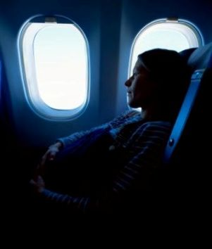 pregnant woman in aeroplane